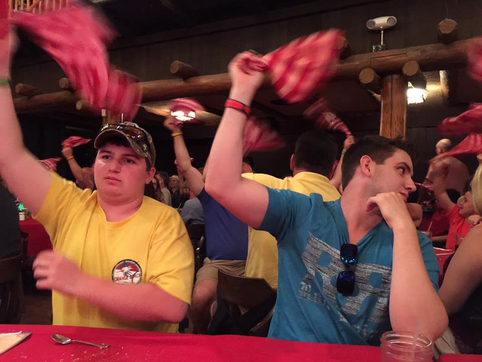 boys waving napkins